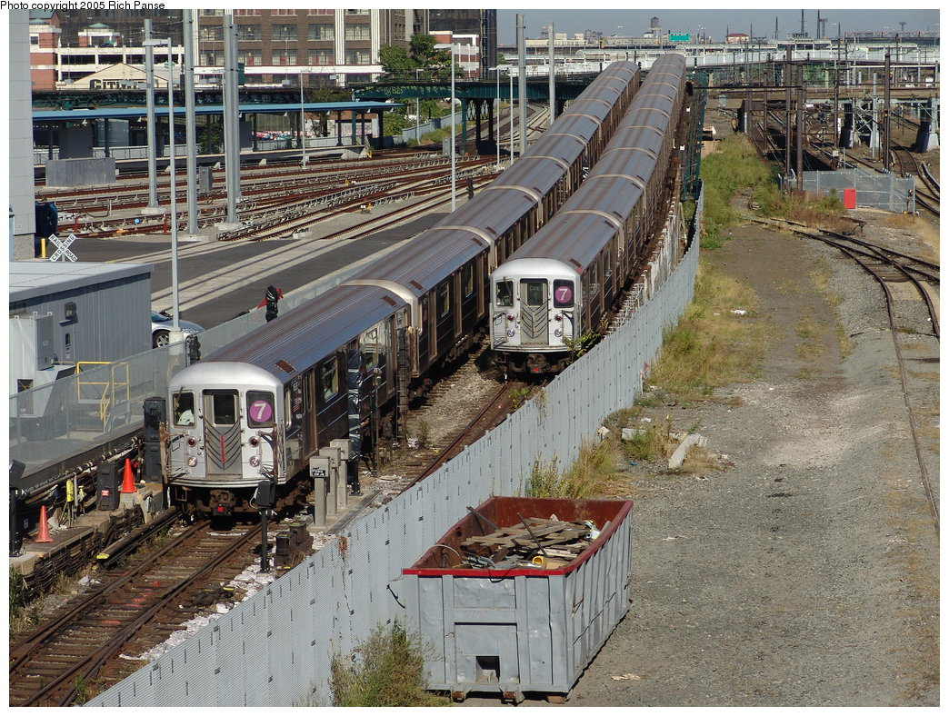 (309k, 1044x788)<br><b>Country:</b> United States<br><b>City:</b> New York<br><b>System:</b> New York City Transit<br><b>Line:</b> IRT Flushing Line<br><b>Location:</b> Viaduct approach east of Hunterspoint Ave. <br><b>Route:</b> 7<br><b>Car:</b> R-62A (Bombardier, 1984-1987)  1666 <br><b>Photo by:</b> Richard Panse<br><b>Date:</b> 10/3/2005<br><b>Notes:</b> View east from street.<br><b>Viewed (this week/total):</b> 0 / 3862