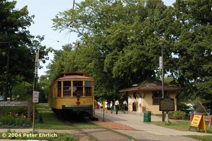 (230k, 720x478)<br><b>Country:</b> United States<br><b>City:</b> Minneapolis, MN<br><b>System:</b> Minnesota Streetcar Museum <br><b>Line:</b> Como-Harriet Line<br><b>Car:</b>  1300 <br><b>Photo by:</b> Peter Ehrlich<br><b>Date:</b> 8/1/2004<br><b>Notes:</b> Linden Hills inbound, with the station building/gift shop.<br><b>Viewed (this week/total):</b> 0 / 1332