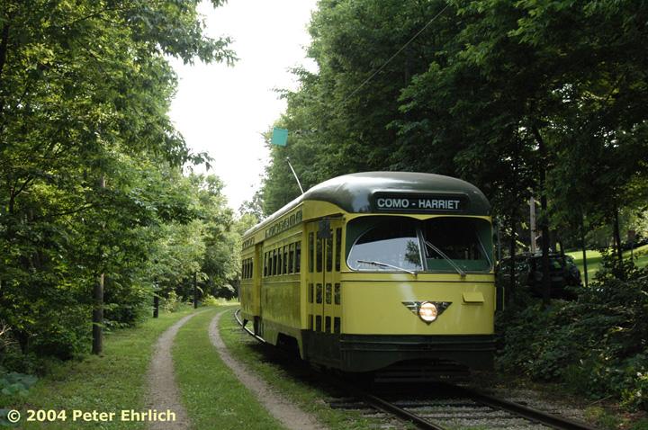 (204k, 720x478)<br><b>Country:</b> United States<br><b>City:</b> Minneapolis, MN<br><b>System:</b> Minnesota Streetcar Museum <br><b>Line:</b> Como-Harriet Line<br><b>Car:</b>  322 <br><b>Photo by:</b> Peter Ehrlich<br><b>Date:</b> 8/1/2004<br><b>Notes:</b> PCC 322 approaching Carbarn.<br><b>Viewed (this week/total):</b> 4 / 1541