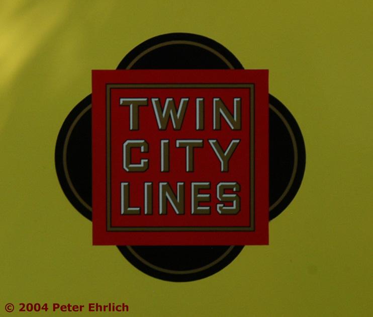 (115k, 742x630)<br><b>Country:</b> United States<br><b>City:</b> Minneapolis, MN<br><b>System:</b> Minnesota Streetcar Museum <br><b>Line:</b> Como-Harriet Line<br><b>Car:</b>  1300 <br><b>Photo by:</b> Peter Ehrlich<br><b>Date:</b> 8/1/2004<br><b>Notes:</b> Twin City Lines logo.<br><b>Viewed (this week/total):</b> 7 / 1243