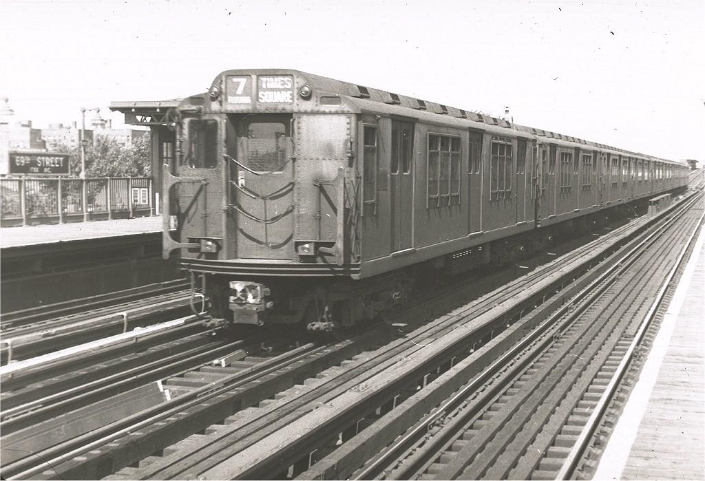 (216k, 1024x699)<br><b>Country:</b> United States<br><b>City:</b> New York<br><b>System:</b> New York City Transit<br><b>Line:</b> IRT Flushing Line<br><b>Location:</b> 69th Street/Fisk Avenue <br><b>Route:</b> 7<br><b>Car:</b> R-12 (American Car & Foundry, 1948)  <br><b>Photo by:</b> Harry Pinsker<br><b>Date:</b> 7/7/1959<br><b>Viewed (this week/total):</b> 4 / 3603