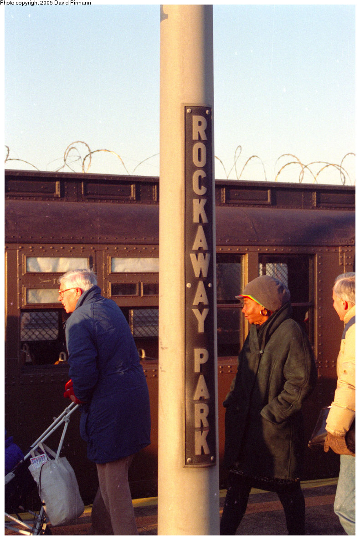 (228k, 790x1186)<br><b>Country:</b> United States<br><b>City:</b> New York<br><b>System:</b> New York City Transit<br><b>Line:</b> IND Rockaway<br><b>Location:</b> Rockaway Park/Beach 116th Street <br><b>Route:</b> Fan Trip<br><b>Car:</b> BMT D-Type Triplex  <br><b>Photo by:</b> David Pirmann<br><b>Date:</b> 12/10/1995<br><b>Notes:</b> Old style station sign at Rockaway Park.<br><b>Viewed (this week/total):</b> 3 / 3306