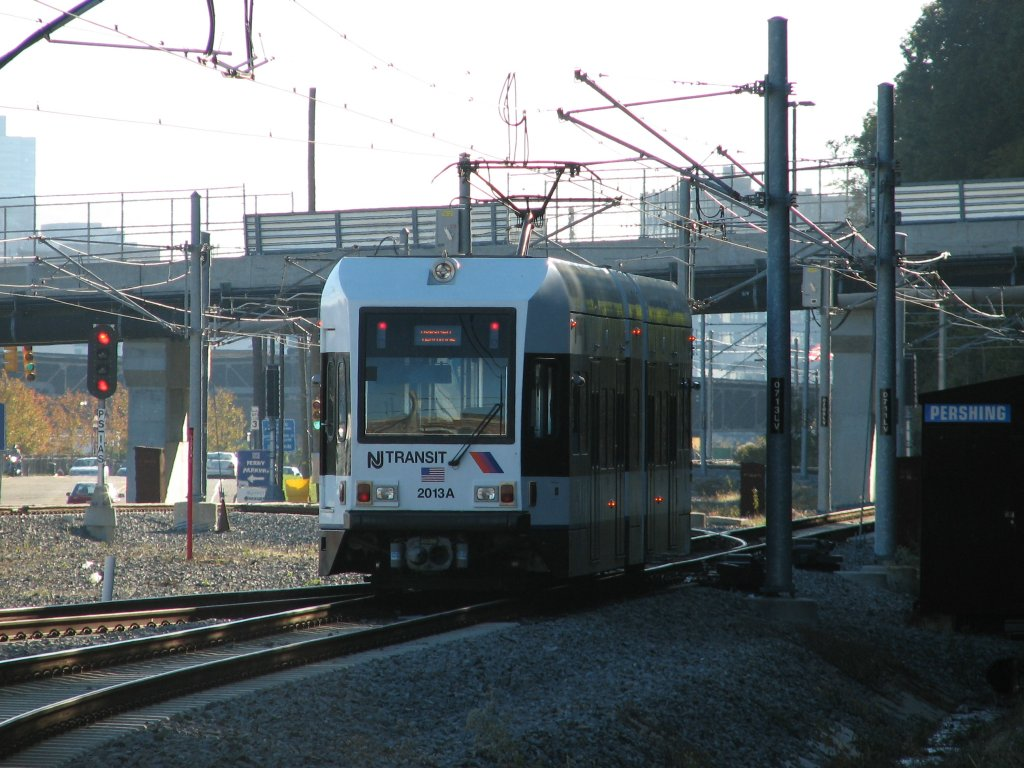 (160k, 1024x768)<br><b>Country:</b> United States<br><b>City:</b> Weehawken, NJ<br><b>System:</b> Hudson Bergen Light Rail<br><b>Location:</b> Port Imperial <br><b>Car:</b> NJT-HBLR LRV (Kinki-Sharyo, 1998-99)  2013 <br><b>Photo by:</b> Brian Weinberg<br><b>Date:</b> 10/30/2005<br><b>Notes:</b> NJT HBLR LRV 2013A @ Port Imperial (second day of service).<br><b>Viewed (this week/total):</b> 0 / 1859