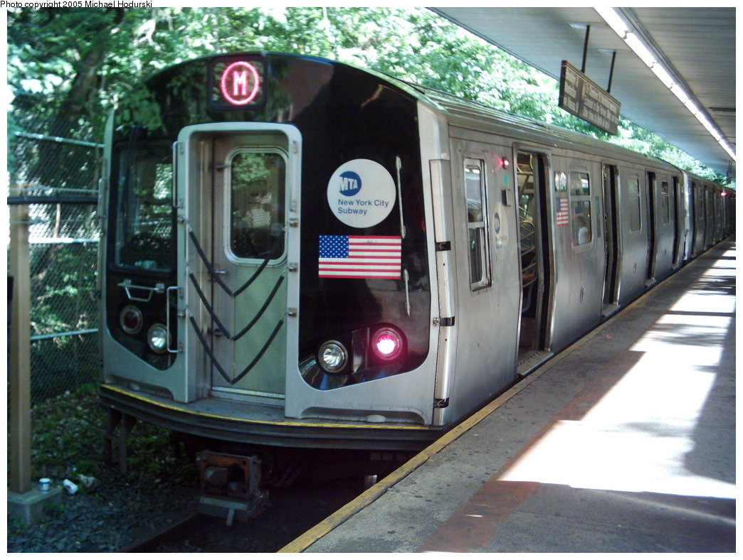 (203k, 1044x788)<br><b>Country:</b> United States<br><b>City:</b> New York<br><b>System:</b> New York City Transit<br><b>Line:</b> BMT Myrtle Avenue Line<br><b>Location:</b> Metropolitan Avenue <br><b>Car:</b> R-143 (Kawasaki, 2001-2002)  <br><b>Photo by:</b> Michael Hodurski<br><b>Date:</b> 8/10/2005<br><b>Notes:</b> Weekend Myrtle shuttle.<br><b>Viewed (this week/total):</b> 0 / 5190