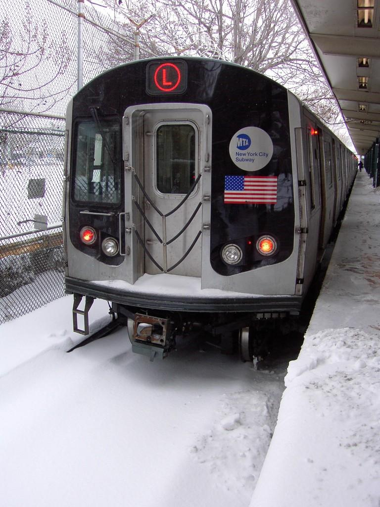 (144k, 768x1024)<br><b>Country:</b> United States<br><b>City:</b> New York<br><b>System:</b> New York City Transit<br><b>Line:</b> BMT Canarsie Line<br><b>Location:</b> Rockaway Parkway <br><b>Route:</b> L<br><b>Car:</b> R-143 (Kawasaki, 2001-2002)  <br><b>Photo by:</b> Brian Weinberg<br><b>Date:</b> 2/17/2003<br><b>Notes:</b> Snow covered tracks - Presidents' Day Blizzard 2003.<br><b>Viewed (this week/total):</b> 1 / 7463