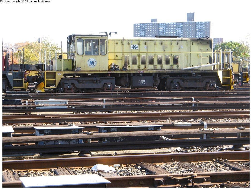 (202k, 1044x788)<br><b>Country:</b> United States<br><b>City:</b> New York<br><b>System:</b> New York City Transit<br><b>Location:</b> Westchester Yard<br><b>Car:</b> R-77 Locomotive  895 <br><b>Photo by:</b> James Matthews<br><b>Date:</b> 11/2/2005<br><b>Viewed (this week/total):</b> 0 / 1760