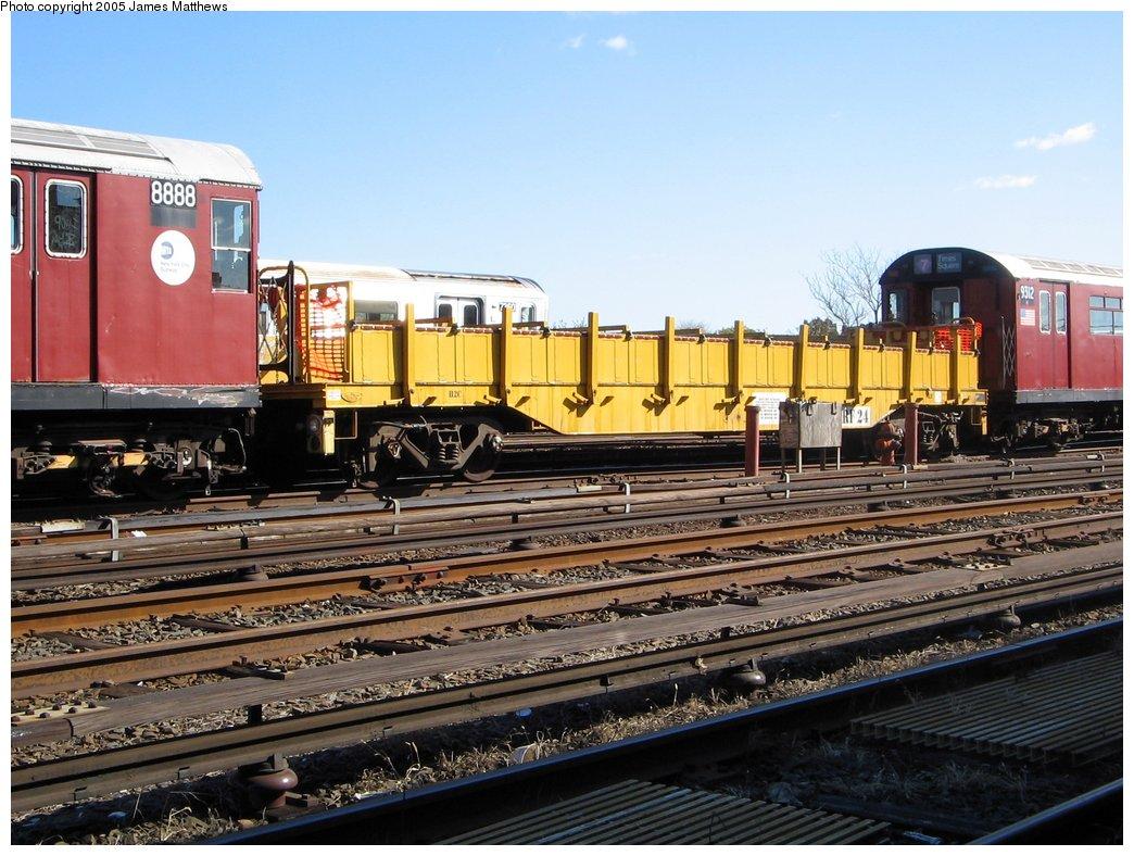 (186k, 1044x788)<br><b>Country:</b> United States<br><b>City:</b> New York<br><b>System:</b> New York City Transit<br><b>Location:</b> Westchester Yard<br><b>Car:</b> R-58 Refuse Collector Flat (Fuji, 1956)  RF24 <br><b>Photo by:</b> James Matthews<br><b>Date:</b> 11/2/2005<br><b>Notes:</b> Refuse flat car.<br><b>Viewed (this week/total):</b> 2 / 3300
