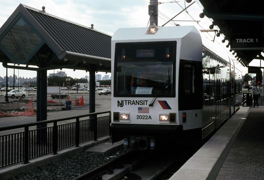 (179k, 882x600)<br><b>Country:</b> United States<br><b>City:</b> Weehawken, NJ<br><b>System:</b> Hudson Bergen Light Rail<br><b>Location:</b> Port Imperial <br><b>Car:</b> NJT-HBLR LRV (Kinki-Sharyo, 1998-99)  2022 <br><b>Photo by:</b> Chris Leverett<br><b>Date:</b> 10/16/2004<br><b>Viewed (this week/total):</b> 0 / 1646