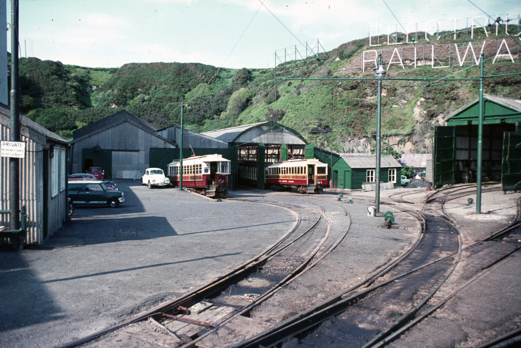 (300k, 1024x685)<br><b>Country:</b> Isle of Man (U.K.)<br><b>System:</b> Manx Electric Railway<br><b>Location:</b> Derby Castle Depot <br><b>Car:</b>  1/5 <br><b>Collection of:</b> David Pirmann/Frank Hicks<br><b>Notes:</b> 1893 G.F.Milnes-built saloon car 1 with 1894 tunnel saloon 5 in the depot. Photo taken approx 1970.<br><b>Viewed (this week/total):</b> 1 / 1578