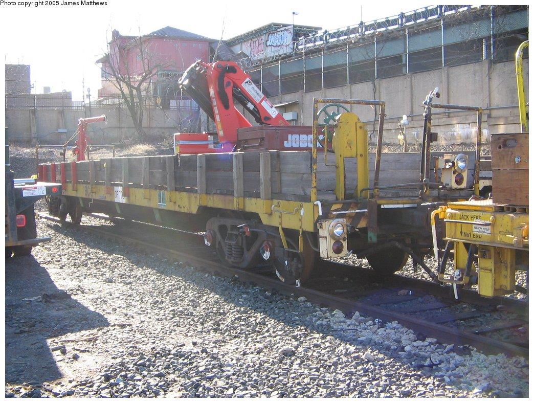 (228k, 1044x788)<br><b>Country:</b> United States<br><b>City:</b> New York<br><b>System:</b> New York City Transit<br><b>Location:</b> 207th Street Yard<br><b>Route:</b> Work Service<br><b>Car:</b> Flat Car 706 <br><b>Photo by:</b> James Matthews<br><b>Date:</b> 11/18/2005<br><b>Notes:</b> Refuse flat car<br><b>Viewed (this week/total):</b> 0 / 2398