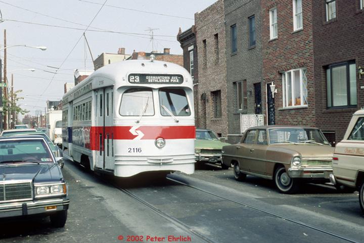 (157k, 720x481)<br><b>Country:</b> United States<br><b>City:</b> Philadelphia, PA<br><b>System:</b> SEPTA (or Predecessor)<br><b>Line:</b> Rt. 23-Germantown <br><b>Location:</b> 12th/Fizgerald <br><b>Route:</b> Rt 23<br><b>Car:</b> PTC/SEPTA Postwar All-electric PCC (St.Louis, 1948)  2116 <br><b>Photo by:</b> Peter Ehrlich<br><b>Date:</b> 10/20/1987<br><b>Notes:</b> 12th Street/Fitzgerald.  Route 23 southbound.<br><b>Viewed (this week/total):</b> 0 / 1435