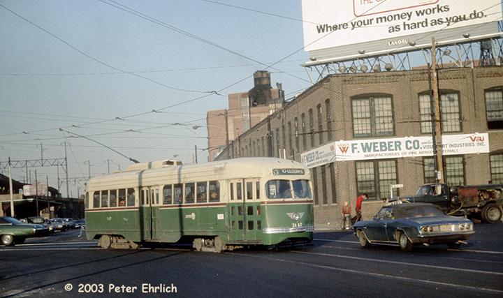(145k, 720x427)<br><b>Country:</b> United States<br><b>City:</b> Philadelphia, PA<br><b>System:</b> SEPTA (or Predecessor)<br><b>Line:</b> Rt. 53-Wayne Ave. <br><b>Location:</b> Wayne/Clarissa--Wayne Junction <br><b>Car:</b> PTC/SEPTA Wartime Air-car PCC (St.Louis, 1942)  2667 <br><b>Photo by:</b> Peter Ehrlich<br><b>Date:</b> 11/20/1973<br><b>Notes:</b> Wayne Junction, Route 53 westbound.<br><b>Viewed (this week/total):</b> 5 / 1797