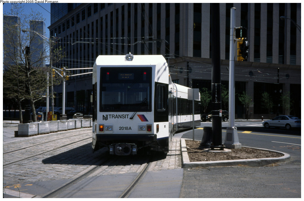 (184k, 1044x691)<br><b>Country:</b> United States<br><b>City:</b> Jersey City, NJ<br><b>System:</b> Hudson Bergen Light Rail<br><b>Location:</b> Exchange Place <br><b>Car:</b> NJT-HBLR LRV (Kinki-Sharyo, 1998-99)  2018 <br><b>Photo by:</b> David Pirmann<br><b>Date:</b> 4/29/2000<br><b>Viewed (this week/total):</b> 2 / 5431