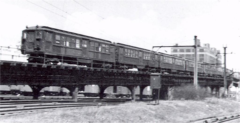 (117k, 1024x524)<br><b>Country:</b> United States<br><b>City:</b> New York<br><b>System:</b> New York City Transit<br><b>Line:</b> IRT Flushing Line<br><b>Location:</b> Viaduct approach east of Hunterspoint Ave. <br><b>Car:</b> Low-V  <br><b>Photo by:</b> Ed Watson/Arthur Lonto Collection<br><b>Collection of:</b> Joe Testagrose<br><b>Date:</b> 1948<br><b>Viewed (this week/total):</b> 4 / 4416