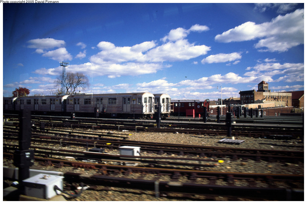 (201k, 1044x695)<br><b>Country:</b> United States<br><b>City:</b> New York<br><b>System:</b> New York City Transit<br><b>Location:</b> Unionport Yard<br><b>Car:</b> R-62A (Bombardier, 1984-1987)  1665 <br><b>Photo by:</b> David Pirmann<br><b>Date:</b> 12/5/1999<br><b>Notes:</b> With R33 8839<br><b>Viewed (this week/total):</b> 0 / 3267