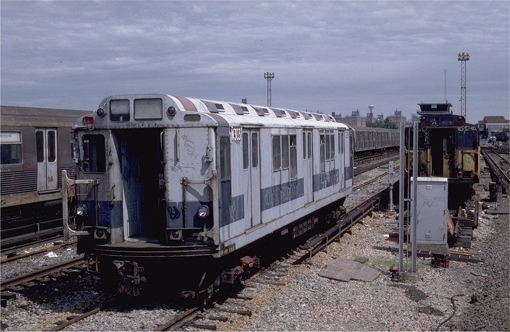 (213k, 1024x666)<br><b>Country:</b> United States<br><b>City:</b> New York<br><b>System:</b> New York City Transit<br><b>Location:</b> Coney Island Yard<br><b>Car:</b> R-12 (American Car & Foundry, 1948) W303 (ex-5756)<br><b>Photo by:</b> Steve Zabel<br><b>Collection of:</b> Joe Testagrose<br><b>Date:</b> 7/4/1982<br><b>Viewed (this week/total):</b> 0 / 2471