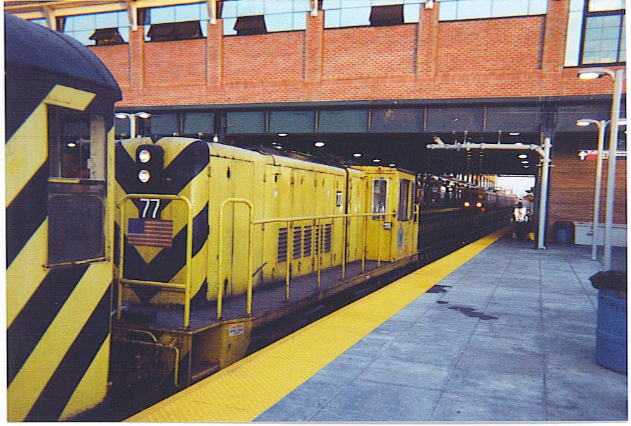 (175k, 894x604)<br><b>Country:</b> United States<br><b>City:</b> New York<br><b>System:</b> New York City Transit<br><b>Location:</b> Coney Island/Stillwell Avenue<br><b>Route:</b> Work Service<br><b>Car:</b> R-52 Locomotive  77 <br><b>Photo by:</b> Michael Hodurski<br><b>Date:</b> 6/7/2004<br><b>Viewed (this week/total):</b> 2 / 2066