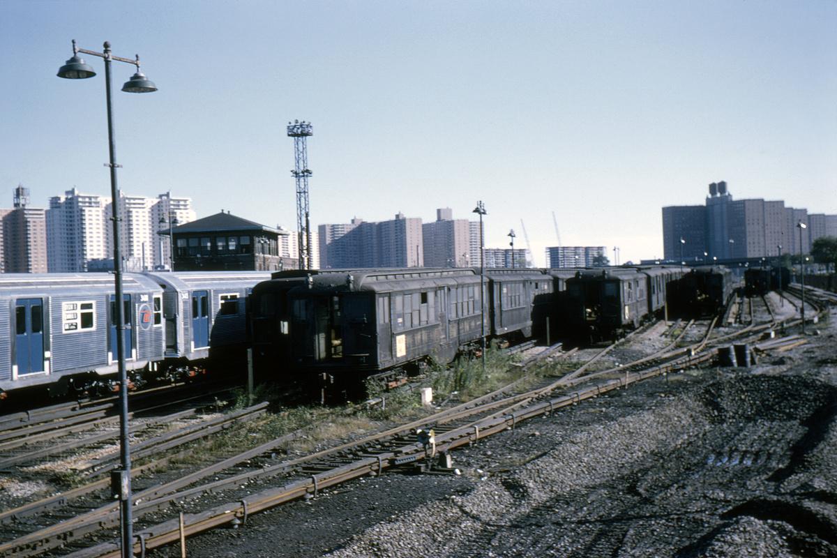 (412k, 1044x705)<br><b>Country:</b> United States<br><b>City:</b> New York<br><b>System:</b> New York City Transit<br><b>Location:</b> Coney Island Yard<br><b>Car:</b> Low-V 20261 (ex-4587)<br><b>Collection of:</b> David Pirmann<br><b>Date:</b> 10/3/1964<br><b>Viewed (this week/total):</b> 0 / 2396