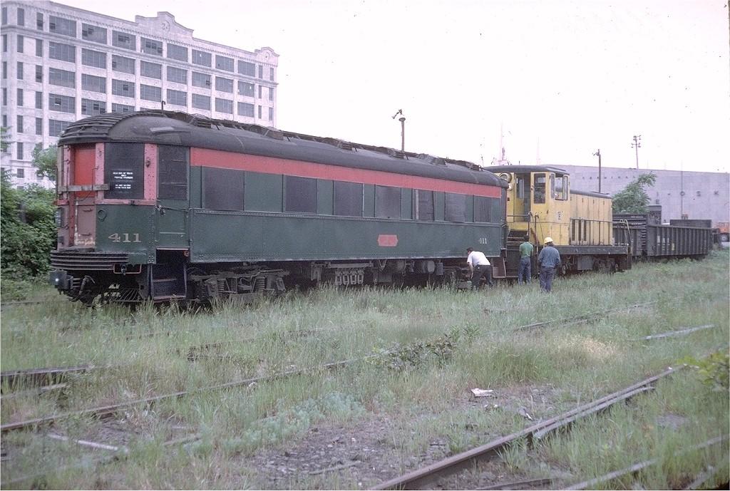 (224k, 1024x689)<br><b>Country:</b> United States<br><b>City:</b> New York<br><b>System:</b> New York City Transit<br><b>Line:</b> South Brooklyn Railway<br><b>Location:</b> SBK Yard (2nd Ave at 38th St.) (SBK)<br><b>Car:</b> Chicago North Shore 411 <br><b>Photo by:</b> Doug Grotjahn<br><b>Collection of:</b> Joe Testagrose<br><b>Date:</b> 6/21/1973<br><b>Notes:</b> Car en route to Trolley Museum of New York.<br><b>Viewed (this week/total):</b> 0 / 1749