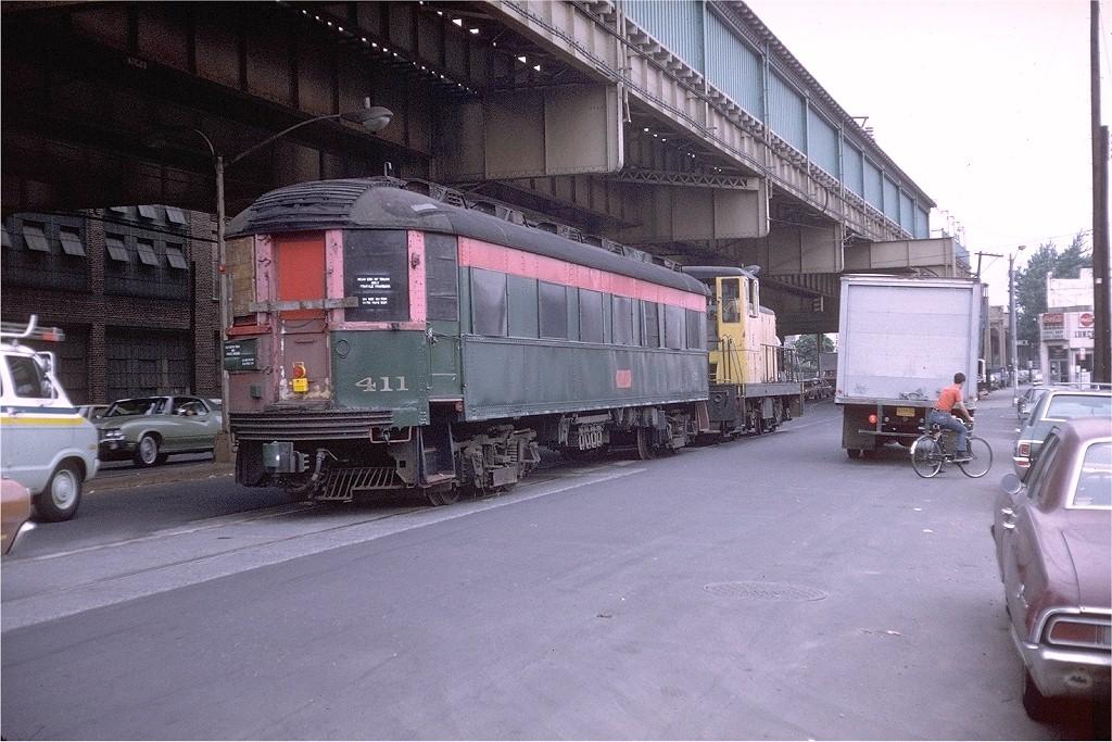 (225k, 1024x683)<br><b>Country:</b> United States<br><b>City:</b> New York<br><b>System:</b> New York City Transit<br><b>Line:</b> South Brooklyn Railway<br><b>Location:</b> McDonald/Ave X (SBK)<br><b>Car:</b> Chicago North Shore 411 <br><b>Photo by:</b> Doug Grotjahn<br><b>Collection of:</b> Joe Testagrose<br><b>Date:</b> 6/21/1973<br><b>Notes:</b> Car en route to Trolley Museum of New York.<br><b>Viewed (this week/total):</b> 1 / 2396