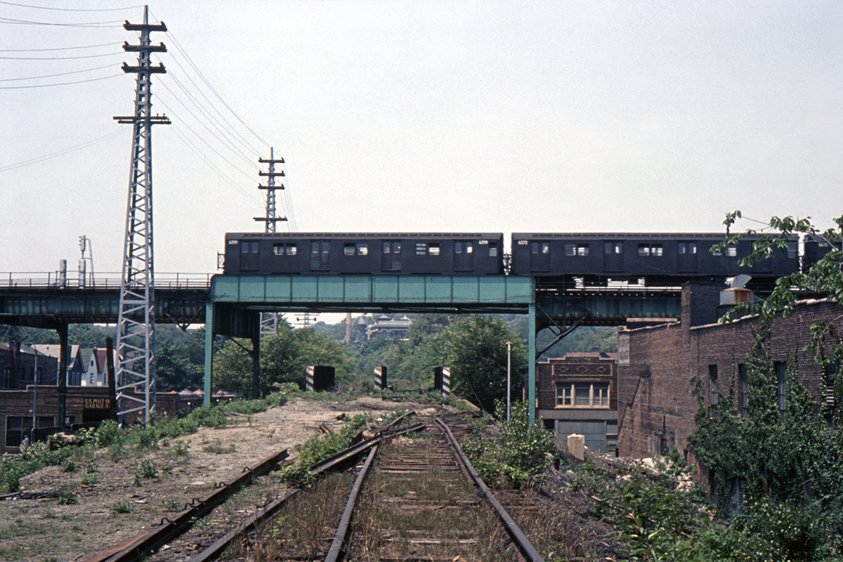 (508k, 1044x676)<br><b>Country:</b> United States<br><b>City:</b> New York<br><b>System:</b> New York City Transit<br><b>Line:</b> BMT Nassau Street/Jamaica Line<br><b>Location:</b> Jamaica Ave @ LIRR Rockaway Line (nr. Jamaica & 98th)<br><b>Route:</b> J<br><b>Car:</b> R-16 (American Car & Foundry, 1955) 6399 <br><b>Collection of:</b> David Pirmann<br><b>Viewed (this week/total):</b> 1 / 3885