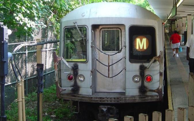 (70k, 674x422)<br><b>Country:</b> United States<br><b>City:</b> New York<br><b>System:</b> New York City Transit<br><b>Line:</b> BMT Myrtle Avenue Line<br><b>Location:</b> Metropolitan Avenue <br><b>Route:</b> M<br><b>Car:</b> R-42 (St. Louis, 1969-1970)   <br><b>Photo by:</b> Phillip Lee<br><b>Date:</b> 8/2/2005<br><b>Viewed (this week/total):</b> 0 / 3804