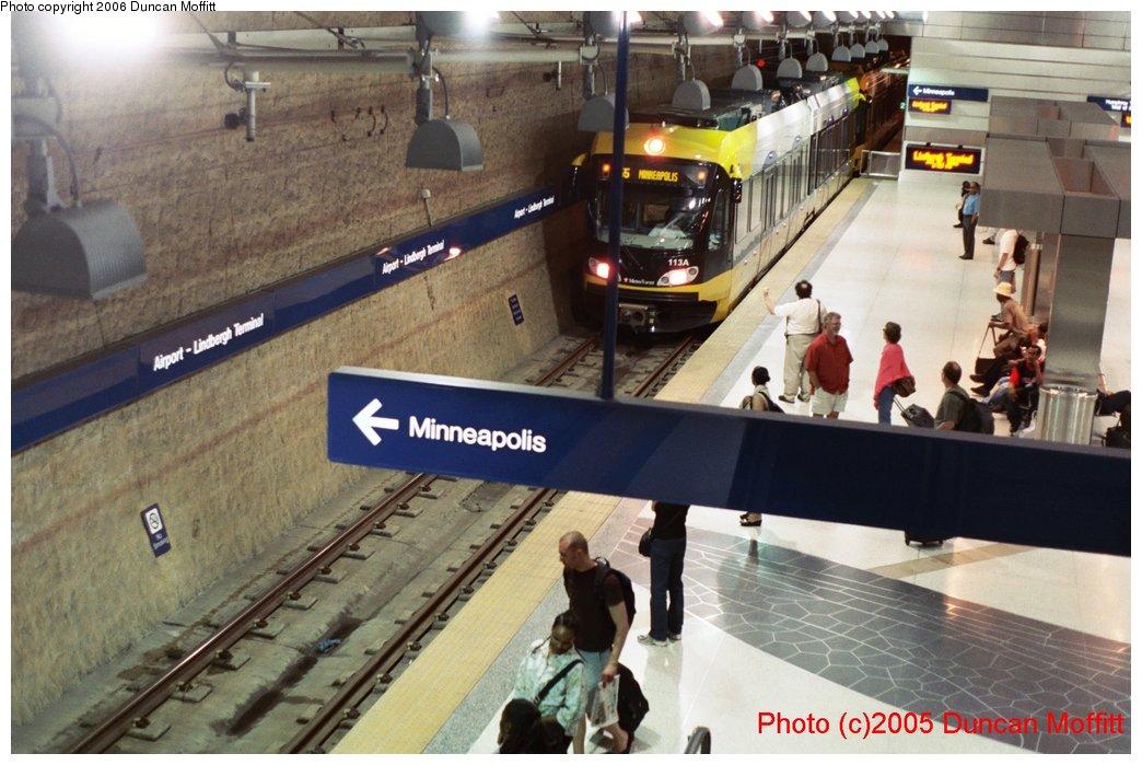 (152k, 1044x699)<br><b>Country:</b> United States<br><b>City:</b> Minneapolis, MN<br><b>System:</b> MNDOT Light Rail Transit<br><b>Line:</b> Hiawatha Line<br><b>Location:</b> <b><u>Airport-Lindbergh Terminal </b></u><br><b>Photo by:</b> Duncan Moffitt<br><b>Date:</b> 2005<br><b>Notes:</b> View of Lindbergh from the mezzanine showing the northbound track and the inlaid wing pattern on the station platform.<br><b>Viewed (this week/total):</b> 0 / 1974