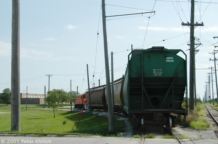 (117k, 720x478)<br><b>Country:</b> United States<br><b>City:</b> Mason City, IA<br><b>System:</b> Iowa Traction<br><b>Location:</b> Iowa Traction--AGP Soybean/S. 19th Street/UP and IC&E Interchange Area<br><b>Photo by:</b> Peter Ehrlich<br><b>Date:</b> 8/31/2005<br><b>Notes:</b> Approaching the IC&E interchange setup track.  The main line, shown on the right, continues eastward about one mile.<br><b>Viewed (this week/total):</b> 0 / 1405