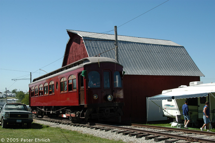 (136k, 720x478)<br><b>Country:</b> United States<br><b>City:</b> Mt. Pleasant, IA<br><b>System:</b> Midwest Old Threshers Museum <br><b>Location:</b> Midwest Threshers Museum -- Grandpa's Barn<br><b>Car:</b>  320 <br><b>Photo by:</b> Peter Ehrlich<br><b>Date:</b> 9/1/2005<br><b>Notes:</b> #320; Passing Grandpa's Barn, enroute to Depot discharge stop.<br><b>Viewed (this week/total):</b> 0 / 1626