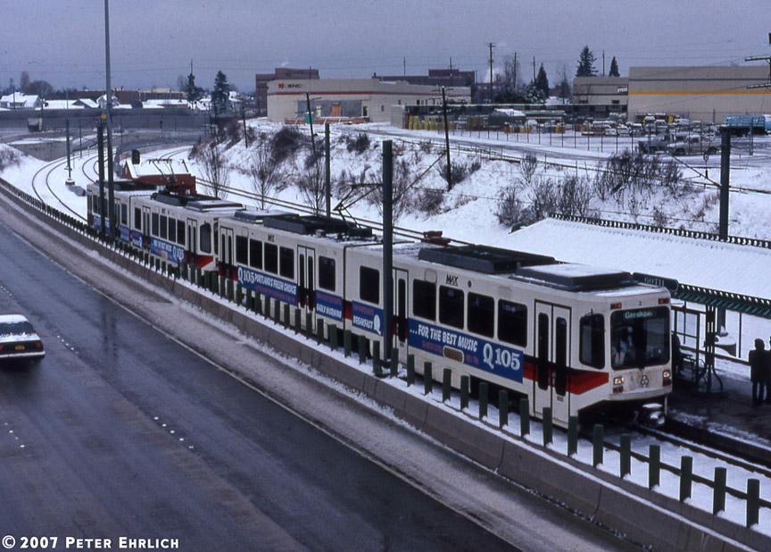 (221k, 864x618)<br><b>Country:</b> United States<br><b>City:</b> Portland, OR<br><b>System:</b> Portland MAX<br><b>Line:</b> MAX Blue (East-West) Line<br><b>Location:</b> NE 60th <br><b>Car:</b> MAX Type 1 (Bombardier)  122+120 <br><b>Photo by:</b> Peter Ehrlich<br><b>Date:</b> 3/2/1989<br><b>Viewed (this week/total):</b> 3 / 2159