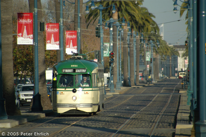 (167k, 720x478)<br><b>Country:</b> United States<br><b>City:</b> San Francisco/Bay Area, CA<br><b>System:</b> SF MUNI<br><b>Location:</b> Embarcadero/Washington <br><b>Route:</b> F-Market<br><b>Car:</b> SF MUNI PCC (Ex-SEPTA) (St. Louis Car Co., 1947-1948)  1051 <br><b>Photo by:</b> Peter Ehrlich<br><b>Date:</b> 11/21/2005<br><b>Notes:</b> Embarcadero/Washington outbound.<br><b>Viewed (this week/total):</b> 2 / 717