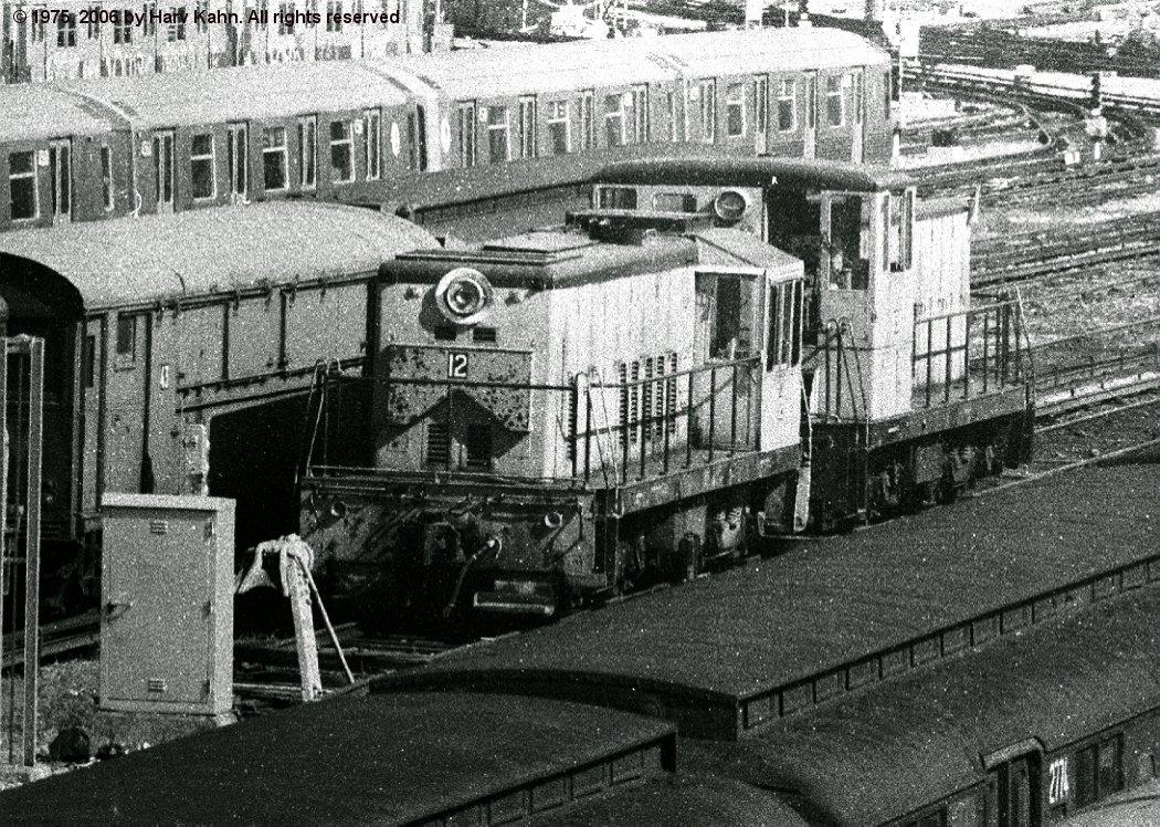 (286k, 1050x748)<br><b>Country:</b> United States<br><b>City:</b> New York<br><b>System:</b> New York City Transit<br><b>Location:</b> Coney Island Yard<br><b>Car:</b> GE 70T Locomotive (SBK)  12 <br><b>Photo by:</b> Harv Kahn<br><b>Date:</b> 7/26/1975<br><b>Viewed (this week/total):</b> 0 / 2545