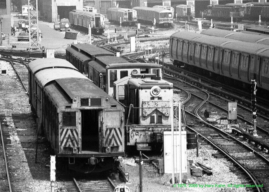(269k, 1050x748)<br><b>Country:</b> United States<br><b>City:</b> New York<br><b>System:</b> New York City Transit<br><b>Location:</b> Coney Island Yard<br><b>Car:</b> GE 70T Locomotive (SBK)  12 <br><b>Photo by:</b> Harv Kahn<br><b>Date:</b> 8/2/1975<br><b>Viewed (this week/total):</b> 1 / 2786