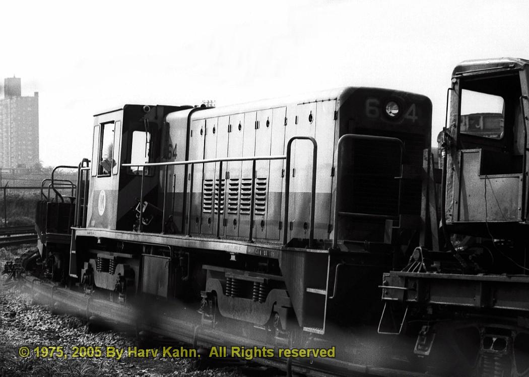 (183k, 1050x748)<br><b>Country:</b> United States<br><b>City:</b> New York<br><b>System:</b> New York City Transit<br><b>Location:</b> Coney Island Yard<br><b>Car:</b> R-47 Locomotive  64 <br><b>Photo by:</b> Harv Kahn<br><b>Date:</b> 5/22/1975<br><b>Viewed (this week/total):</b> 0 / 2008