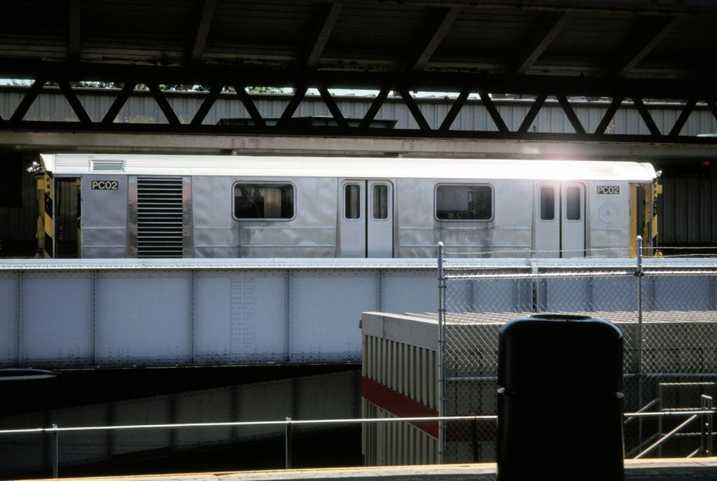 (205k, 1024x687)<br><b>Country:</b> United States<br><b>City:</b> New York<br><b>System:</b> New York City Transit<br><b>Line:</b> IRT White Plains Road Line<br><b>Location:</b> East 180th Street <br><b>Car:</b> R-65 Pump Car 02 <br><b>Photo by:</b> Chris Leverett<br><b>Date:</b> 7/26/1998<br><b>Notes:</b> Work train on former NYW&B platform at E. 180th St.<br><b>Viewed (this week/total):</b> 0 / 4809