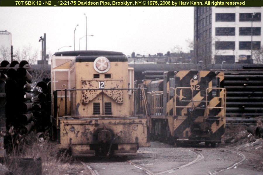 (107k, 900x598)<br><b>Country:</b> United States<br><b>City:</b> New York<br><b>System:</b> New York City Transit<br><b>Location:</b> 39th Street, west of 3rd Avenue at Davidson's Pipe Works<br><b>Car:</b> R-47 (SBK) Locomotive  N2 <br><b>Photo by:</b> Harv Kahn<br><b>Date:</b> 12/21/1975<br><b>Viewed (this week/total):</b> 0 / 1718
