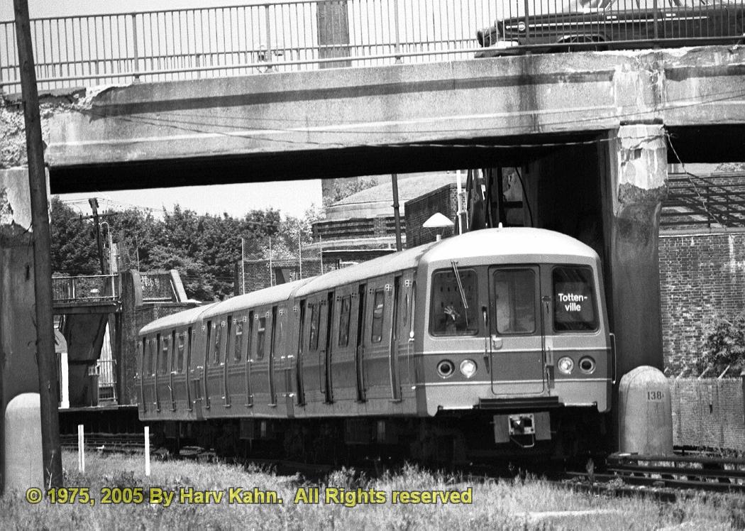 (641k, 1050x748)<br><b>Country:</b> United States<br><b>City:</b> New York<br><b>System:</b> New York City Transit<br><b>Line:</b> SIRT<br><b>Location:</b> Tompkinsville <br><b>Car:</b> R-44 SIRT (St. Louis, 1971-1973)  <br><b>Photo by:</b> Harv Kahn<br><b>Date:</b> 6/10/1975<br><b>Viewed (this week/total):</b> 1 / 4383