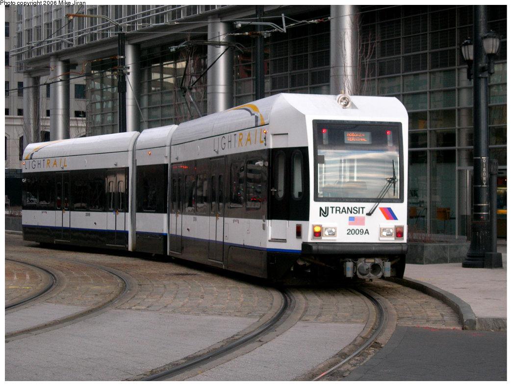 (221k, 1044x788)<br><b>Country:</b> United States<br><b>City:</b> Jersey City, NJ<br><b>System:</b> Hudson Bergen Light Rail<br><b>Location:</b> Essex Street <br><b>Car:</b> NJT-HBLR LRV (Kinki-Sharyo, 1998-99)  2009 <br><b>Photo by:</b> Mike Jiran<br><b>Date:</b> 2/5/2006<br><b>Notes:</b> Note new HBLR logo on car.<br><b>Viewed (this week/total):</b> 0 / 1867
