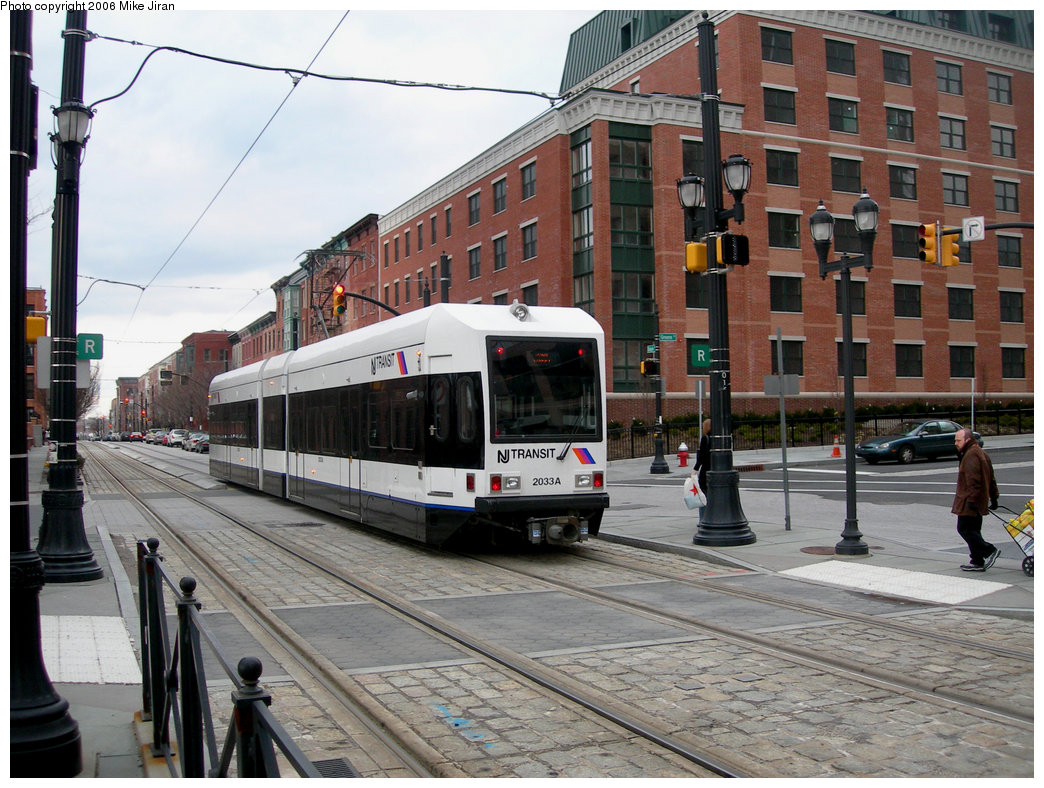 (263k, 1044x788)<br><b>Country:</b> United States<br><b>City:</b> Jersey City, NJ<br><b>System:</b> Hudson Bergen Light Rail<br><b>Location:</b> Essex Street <br><b>Car:</b> NJT-HBLR LRV (Kinki-Sharyo, 1998-99)  2033 <br><b>Photo by:</b> Mike Jiran<br><b>Date:</b> 2/5/2006<br><b>Notes:</b> New car 2033 with new logo.<br><b>Viewed (this week/total):</b> 0 / 2290