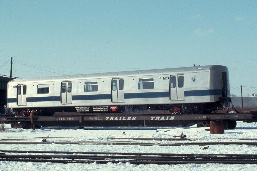 (75k, 900x600)<br><b>Country:</b> United States<br><b>City:</b> Secaucus, NJ<br><b>System:</b> New York City Transit<br><b>Location:</b> Croxton Yard (NYCTA Equipment Delivery)<br><b>Car:</b> R-46 (Pullman-Standard, 1974-75) 557 <br><b>Photo by:</b> Harv Kahn<br><b>Date:</b> 2/7/1976<br><b>Viewed (this week/total):</b> 0 / 2466