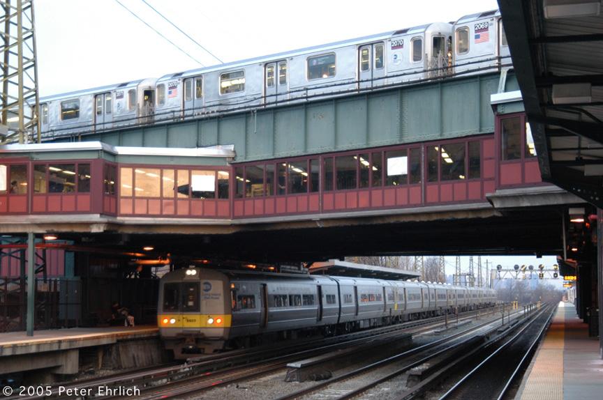(202k, 864x574)<br><b>Country:</b> United States<br><b>City:</b> New York<br><b>System:</b> New York City Transit<br><b>Line:</b> IRT Flushing Line<br><b>Location:</b> 61st Street/Woodside <br><b>Route:</b> 7<br><b>Car:</b> R-62A (Bombardier, 1984-1987)  2070 <br><b>Photo by:</b> Peter Ehrlich<br><b>Date:</b> 12/19/2005<br><b>Notes:</b> With LIRR 9920.<br><b>Viewed (this week/total):</b> 0 / 3581