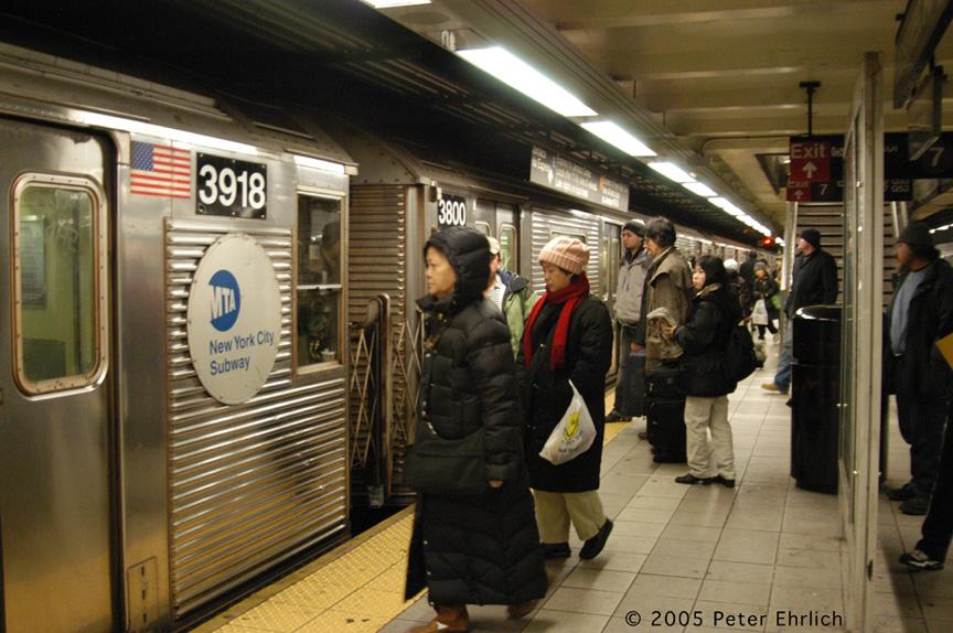 (218k, 864x574)<br><b>Country:</b> United States<br><b>City:</b> New York<br><b>System:</b> New York City Transit<br><b>Line:</b> IND Queens Boulevard Line<br><b>Location:</b> Roosevelt Avenue <br><b>Route:</b> E<br><b>Car:</b> R-32 (Budd, 1964)  3918 <br><b>Photo by:</b> Peter Ehrlich<br><b>Date:</b> 12/30/2005<br><b>Viewed (this week/total):</b> 0 / 4152