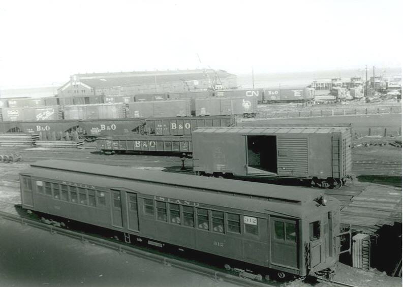 (146k, 793x565)<br><b>Country:</b> United States<br><b>City:</b> New York<br><b>System:</b> New York City Transit<br><b>Line:</b> SIRT<br><b>Location:</b> St. George <br><b>Car:</b> SIRT ME-1 (Motor) 312 <br><b>Collection of:</b> S. Phetterplace<br><b>Date:</b> 1965<br><b>Viewed (this week/total):</b> 1 / 3714