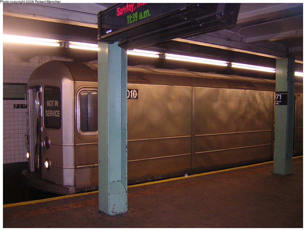 (218k, 1044x788)<br><b>Country:</b> United States<br><b>City:</b> New York<br><b>System:</b> New York City Transit<br><b>Line:</b> IND Queens Boulevard Line<br><b>Location:</b> 71st/Continental Aves./Forest Hills <br><b>Route:</b> Work Service<br><b>Car:</b> R-127/R-134 (Kawasaki, 1991-1996) EP010 <br><b>Photo by:</b> Robert Mencher<br><b>Date:</b> 3/26/2006<br><b>Viewed (this week/total):</b> 3 / 3602