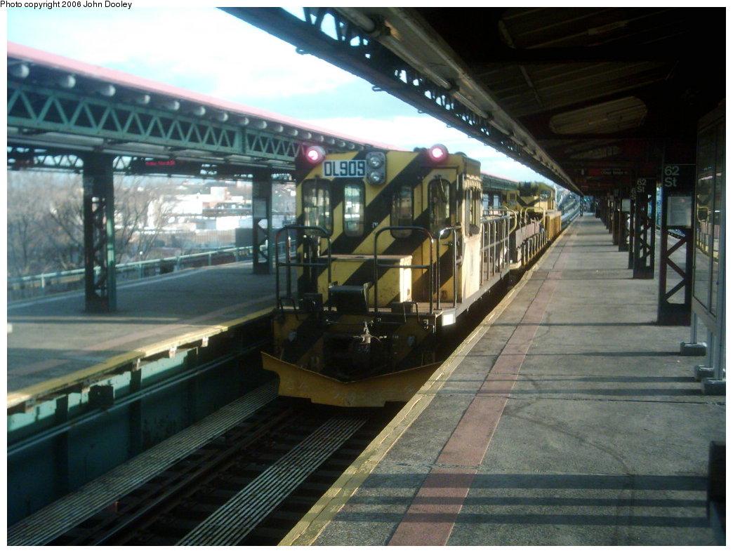 (175k, 1044x788)<br><b>Country:</b> United States<br><b>City:</b> New York<br><b>System:</b> New York City Transit<br><b>Line:</b> BMT West End Line<br><b>Location:</b> 62nd Street <br><b>Route:</b> Work Service<br><b>Car:</b> R-120 Locomotive  909 <br><b>Photo by:</b> John Dooley<br><b>Collection of:</b> Michael Hodurski<br><b>Date:</b> 3/24/2006<br><b>Viewed (this week/total):</b> 2 / 2177