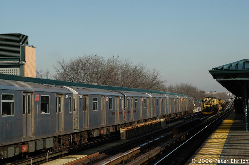 (167k, 864x574)<br><b>Country:</b> United States<br><b>City:</b> New York<br><b>System:</b> New York City Transit<br><b>Line:</b> IRT Woodlawn Line<br><b>Location:</b> 161st Street/River Avenue (Yankee Stadium) <br><b>Car:</b> R-142 (Option Order, Bombardier, 2002-2003)  7095 <br><b>Photo by:</b> Peter Ehrlich<br><b>Date:</b> 1/24/2006<br><b>Notes:</b> With work train W53.<br><b>Viewed (this week/total):</b> 0 / 2983