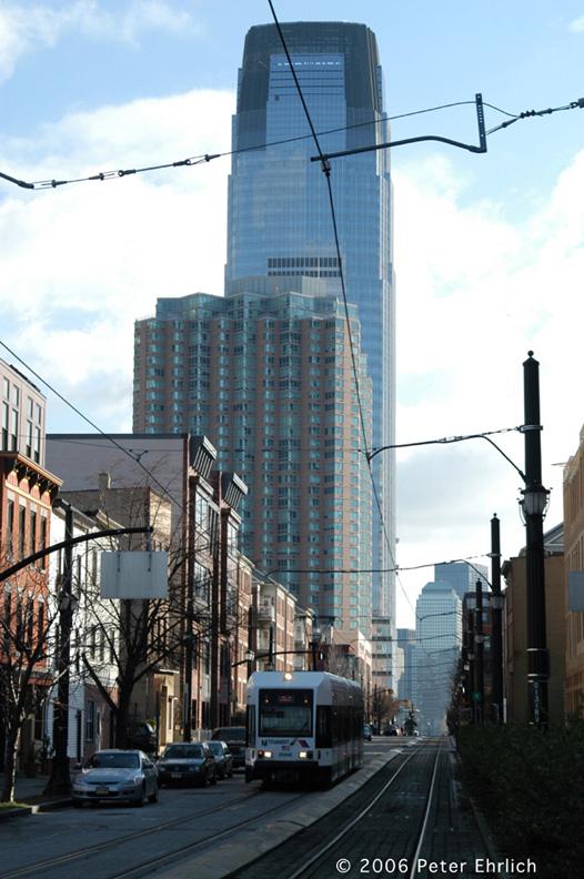(169k, 526x792)<br><b>Country:</b> United States<br><b>City:</b> Jersey City, NJ<br><b>System:</b> Hudson Bergen Light Rail<br><b>Location:</b> Along Essex Street <br><b>Car:</b> NJT-HBLR LRV (Kinki-Sharyo, 1998-99)  2024 <br><b>Photo by:</b> Peter Ehrlich<br><b>Date:</b> 1/25/2006<br><b>Notes:</b> At Essex/Warren Streets outbound.<br><b>Viewed (this week/total):</b> 0 / 1415