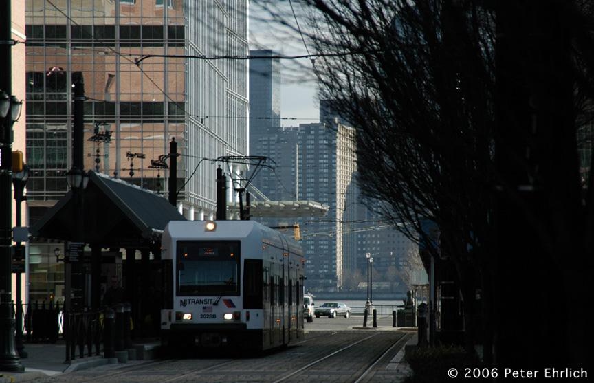 (181k, 864x557)<br><b>Country:</b> United States<br><b>City:</b> Jersey City, NJ<br><b>System:</b> Hudson Bergen Light Rail<br><b>Location:</b> Essex Street <br><b>Car:</b> NJT-HBLR LRV (Kinki-Sharyo, 1998-99)  2028 <br><b>Photo by:</b> Peter Ehrlich<br><b>Date:</b> 1/25/2006<br><b>Viewed (this week/total):</b> 0 / 1590