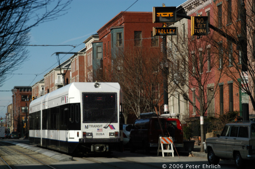 (218k, 864x574)<br><b>Country:</b> United States<br><b>City:</b> Jersey City, NJ<br><b>System:</b> Hudson Bergen Light Rail<br><b>Location:</b> Along Essex Street <br><b>Car:</b> NJT-HBLR LRV (Kinki-Sharyo, 1998-99)  2028 <br><b>Photo by:</b> Peter Ehrlich<br><b>Date:</b> 1/25/2006<br><b>Notes:</b> Essex west of Greene Street outbound.  Note illuminated trolley warning signs.<br><b>Viewed (this week/total):</b> 0 / 1274