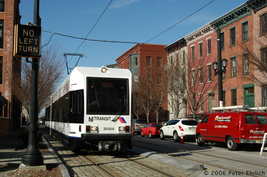 (249k, 864x574)<br><b>Country:</b> United States<br><b>City:</b> Jersey City, NJ<br><b>System:</b> Hudson Bergen Light Rail<br><b>Location:</b> Along Essex Street <br><b>Car:</b> NJT-HBLR LRV (Kinki-Sharyo, 1998-99)  2035 <br><b>Photo by:</b> Peter Ehrlich<br><b>Date:</b> 1/25/2006<br><b>Notes:</b> Essex/Washington Streets inbound.<br><b>Viewed (this week/total):</b> 0 / 1441